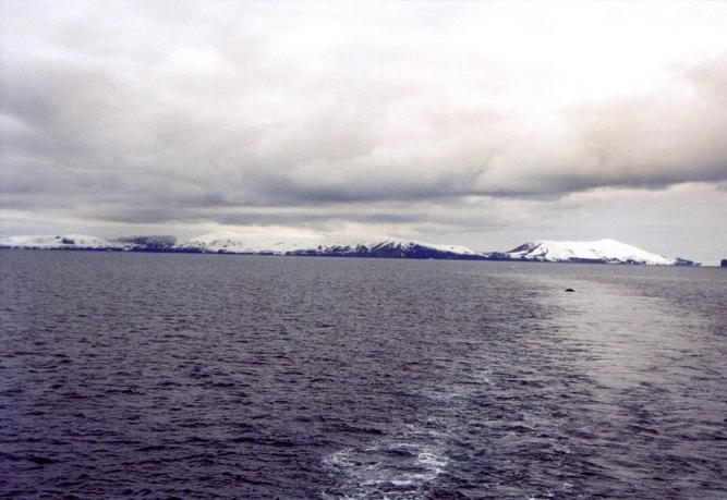 Humpback Whale and Deception Island: Stonethrow Ridge (centre); to the right: Vapour Col and Mt. Kirkwood