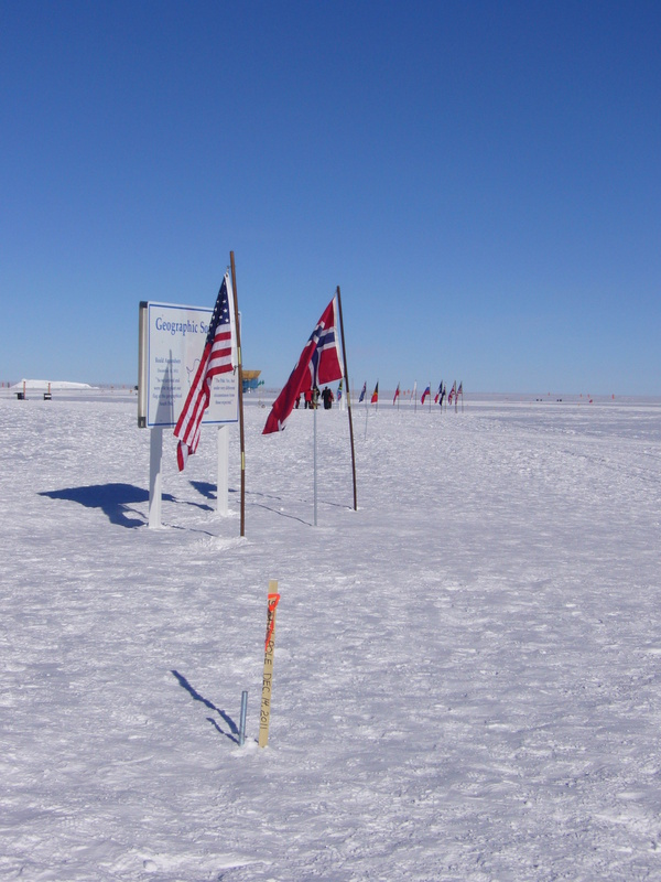 Pole history: centennial (wooden stake), 1<sup>st</sup> January 2011 (between two flags), former stakes and Ceremonial Pole (surrounded by flags)