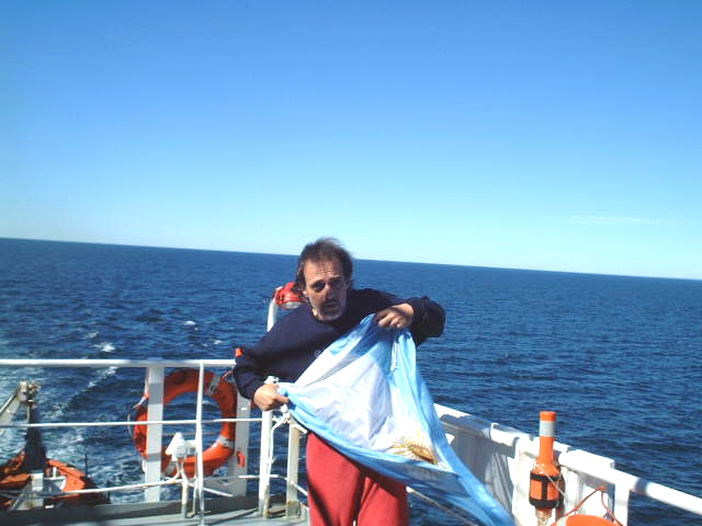 Captain Peter prepares the courtesy flag for hoisting