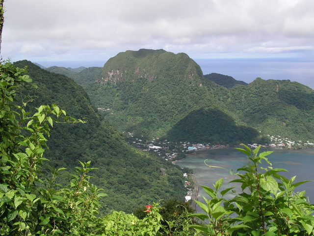 Rainmaker Mountain often catches clouds at Pago Pago.