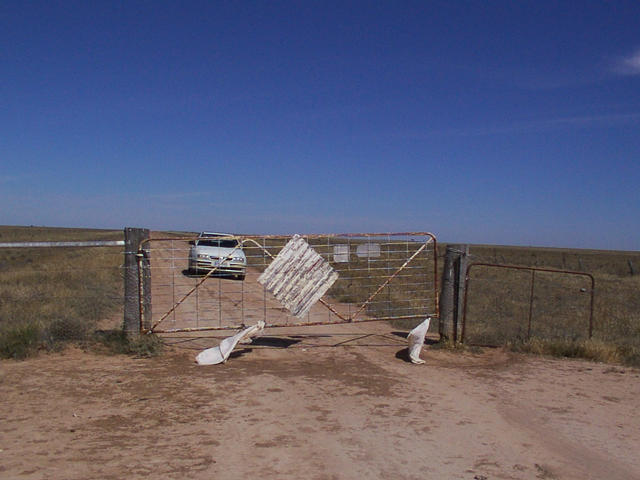 A gate in the middle of the road next to the confluence