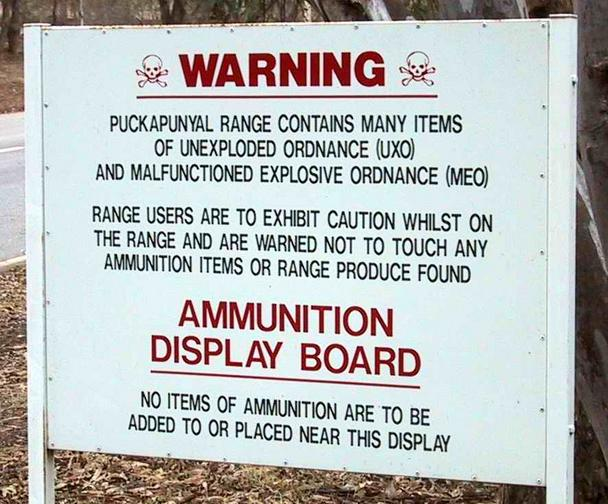 The sign warns of unexploded munitions
