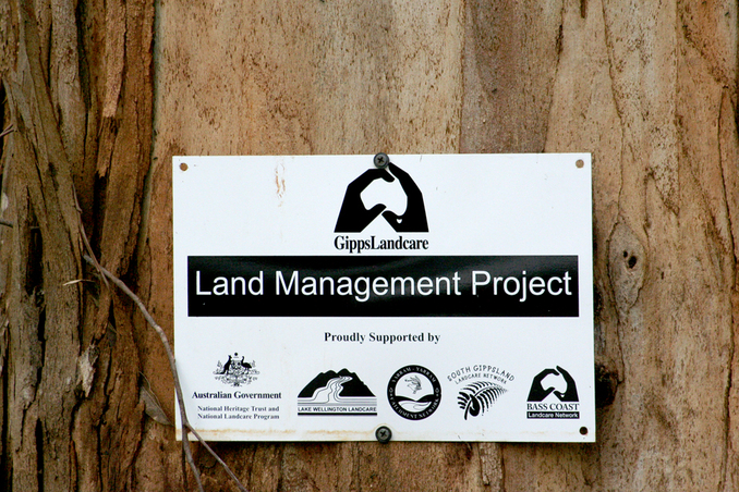 Land Management Project sign showing sponsors.