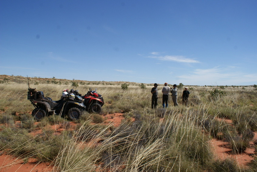 Expedition members and quads at the confluence site