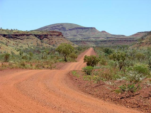 The road south of Mt Florence with the Hammersley Range in the distance