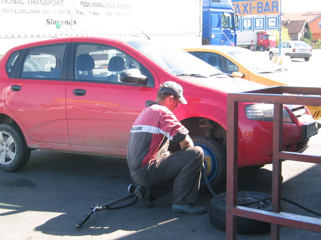Getting my tire replaced at the Taxi-Bar