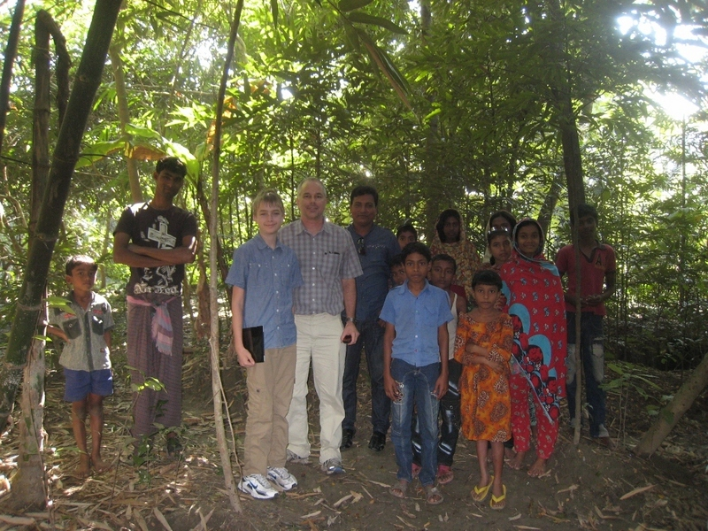 Kevin, Tony, and Kabir and neighborhood children