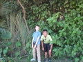 #8: Shuchak and Kevin standing at the row of trees