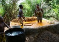 #10: Women extracting the oil in a pit