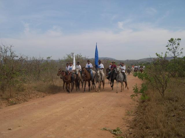 The troop carring a flag to Nossa Senhora da Aparecida party