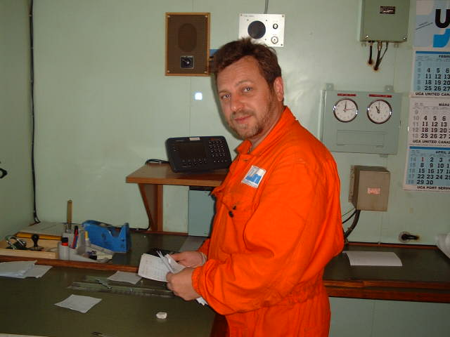 2nd Officer Volodymyr Sydorenko studying the draft of the report