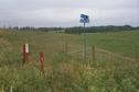 #8: The intersection of Range Road 10 and Township Road 352 and a pipeline warning sign found near confluence.