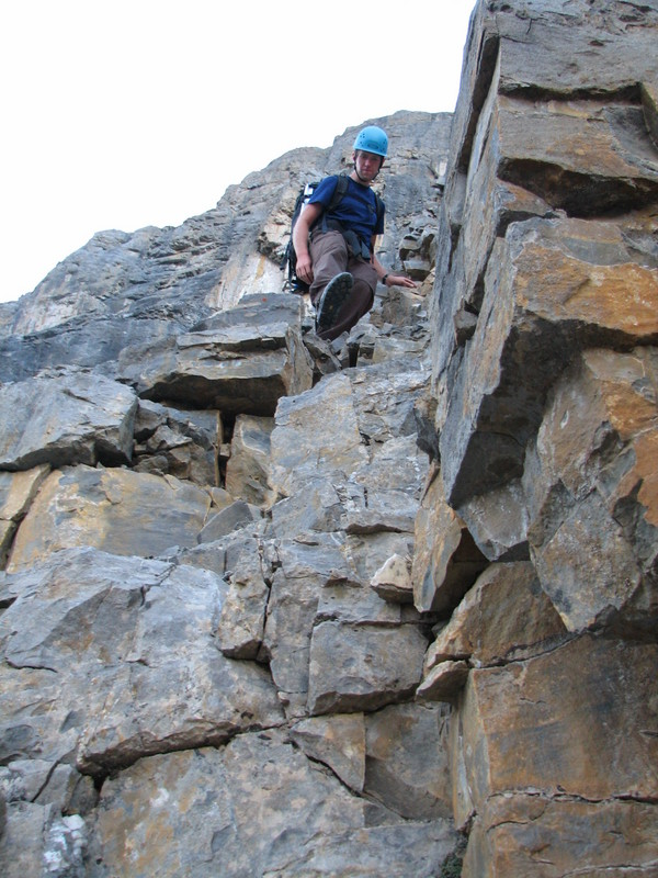 Brendan downclimbing one of the more dangerous gullies.