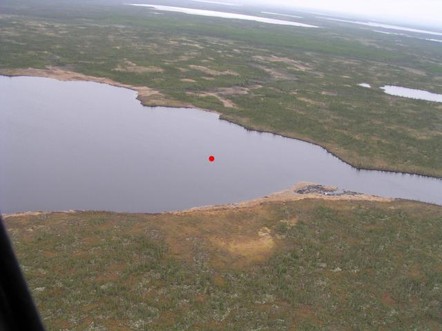 The red dot indicates the exact spot over an unnamed lake.