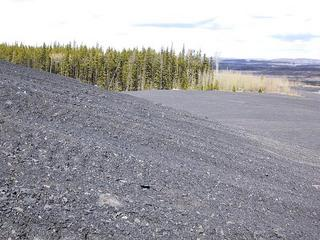 #1: View north from the confluence site on a pile of coaly shale