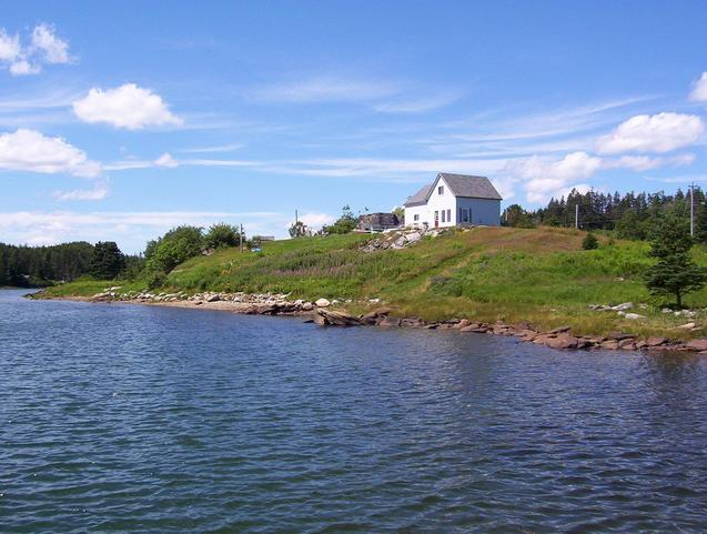 The guest house and waterfront, as seen from the dock