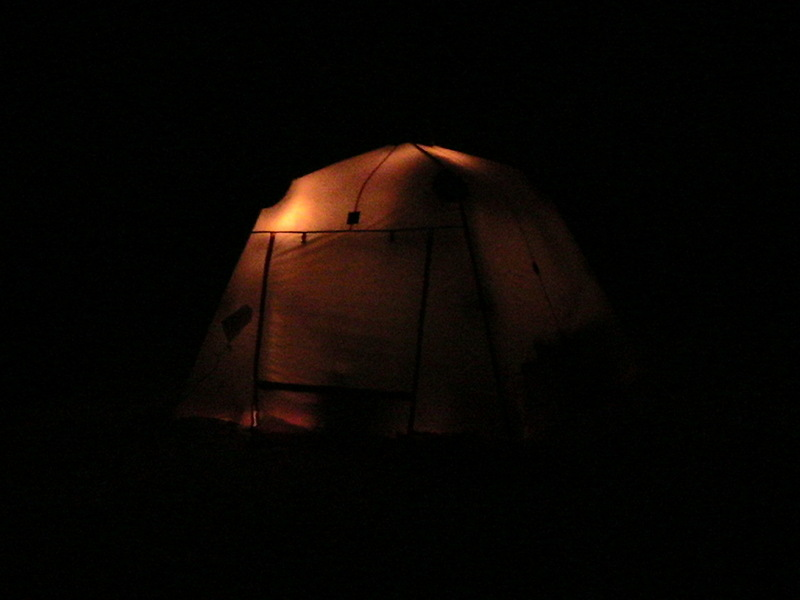 A photo of our tent, the arctic oven, taken at night while camped near the confluence. Looks like a large pumpkin.