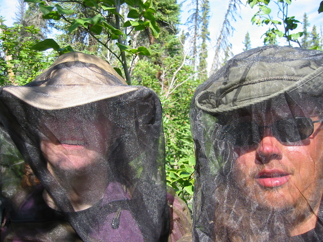The two of us at the confluence in bug netting