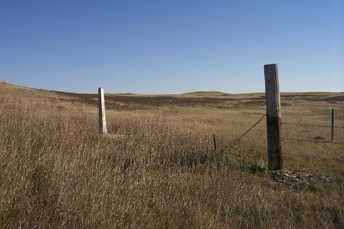 Tri-corner monument.  The pole marks the northeast corner of Montana.