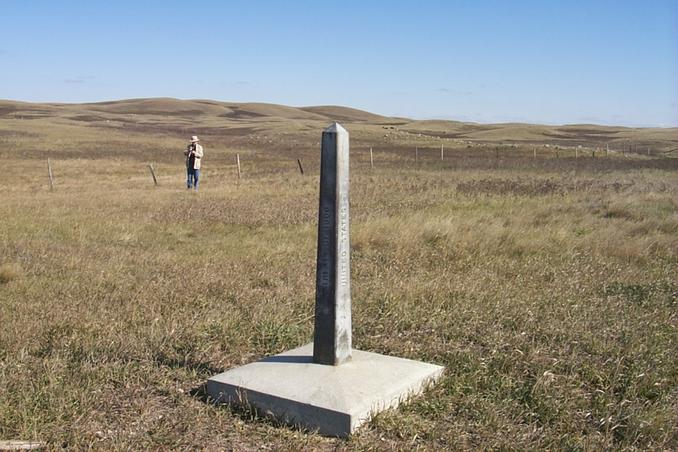 View northeast showing border monument and Alan standing at the confluence.