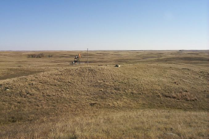 Overview of tri-corner (in center beyond the rock).  Saskatchewan in foreground, North Dakota on left beyond trees, Montana on distant right.