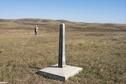 #5: View northeast showing border monument and Alan standing at the confluence.