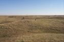 #9: Overview of tri-corner (in center beyond the rock).  Saskatchewan in foreground, North Dakota on left beyond trees, Montana on distant right.