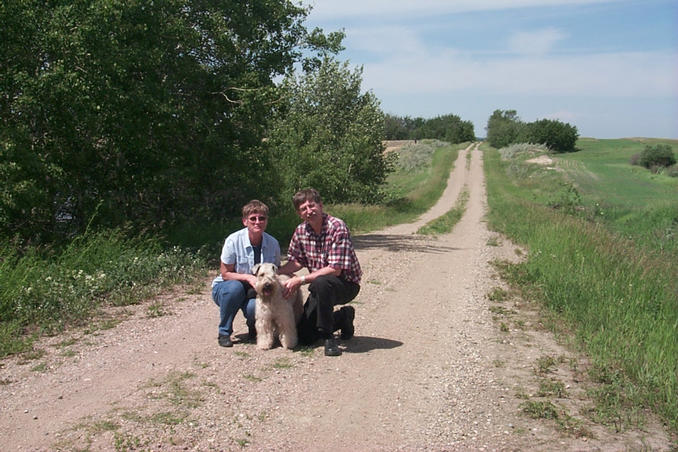 The three of us posed on the road leading to 51°N.  There is a pond directly behind the trees to the left of the picture.
