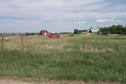 #8: A typical Saskatchewan farm ... this one just one kilometer east of the confluence.