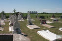 #9: A small cemetery situated directly east of the confluence. The steel grain bins in the background are the same ones seen in the view looking east.