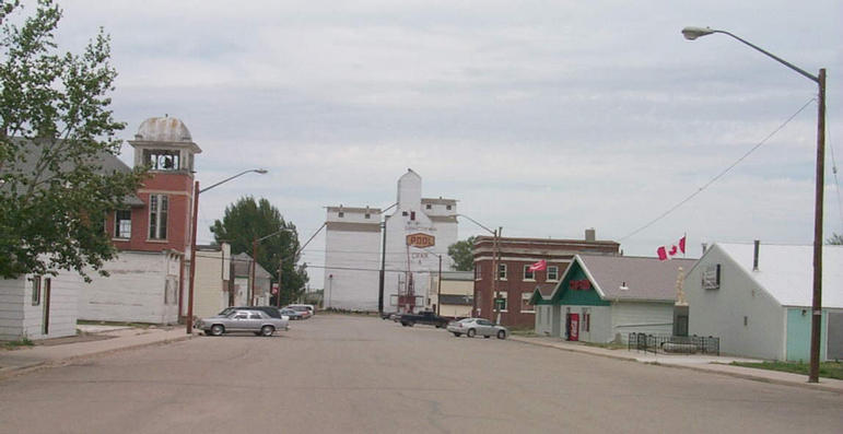 Main Street in the town of Craik. The building on the left with the bell tower is dated 1913.