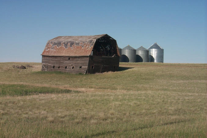 An old barn and grain bins in the area.