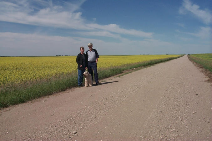 Carolyn, Max and Alan in front of a canola (aka rape) field.