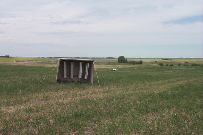 We think these are bee hives situated just east of the confluence.