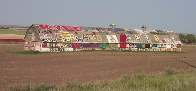 "The Graduates of 2001 ""graffiti barn"" just outside of Kerrobert."