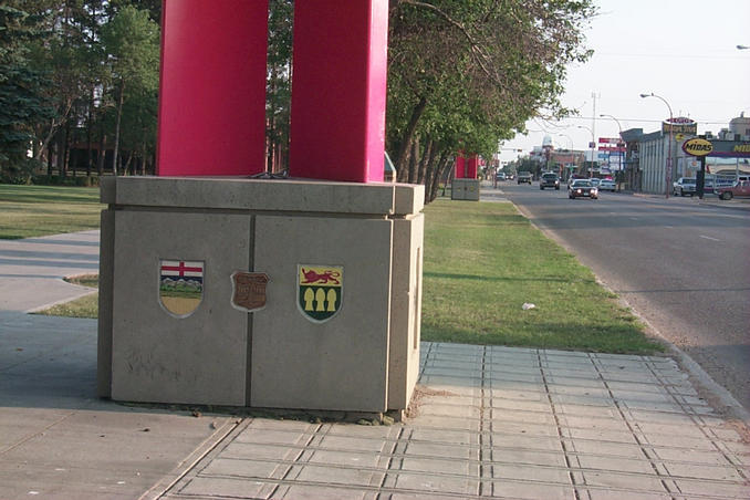 The bases of the border markers with provincial and city shields.