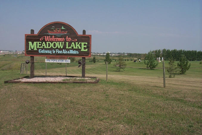 "Meadow Lake town sign.  ""Gateway to Pure Air and Water"""