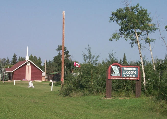 "Welcome sign at Loon Lake. ""Playground of the North""."
