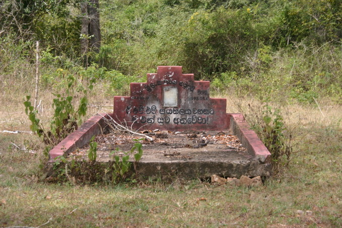 Tombstone with Sinhalese inscription by the path to the point