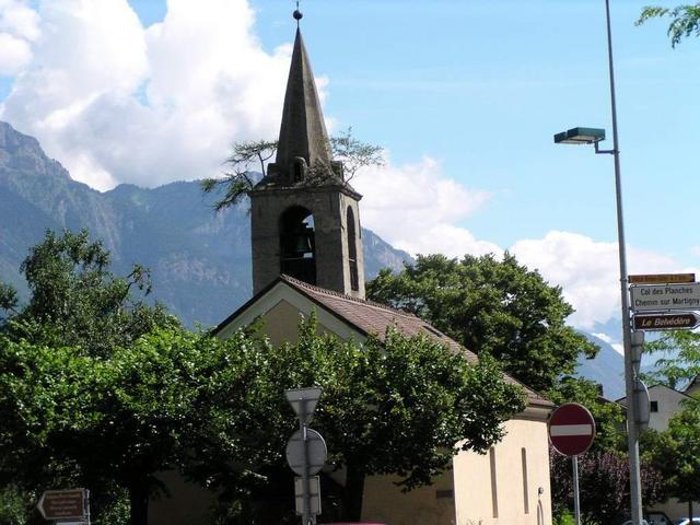 Trees are growing on a church tower at Martigny