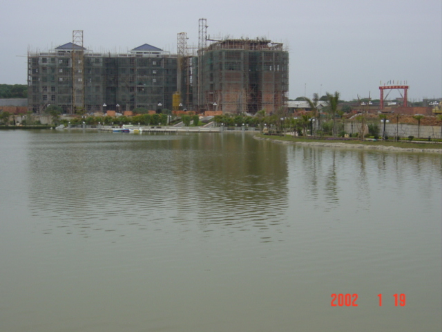 The confluence is in front of those buildings.