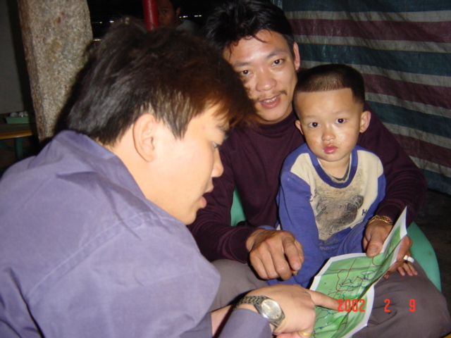 Li Chongxin (foreground) and his friend examine my map