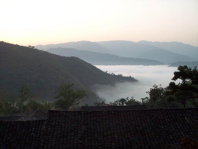Sea of clouds morning view from farmhouse.
