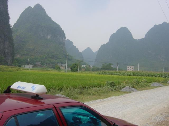 Confluence is in a cultivated valley nestled between tall karst mountains, 1.4 kilometres southwest of the road
