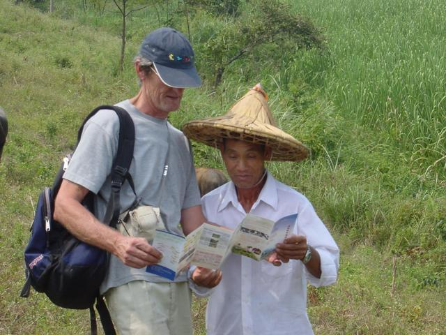 Jim gives a local farmer a leaflet outlining the KERP programme