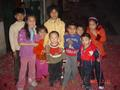 #3: Children surrounded by the debris of spent firecrackers