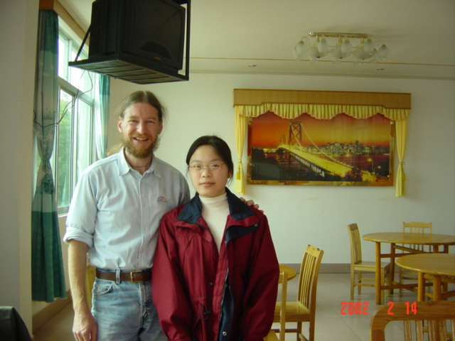 "Jiang Cuiwen (""Man""), and a rather dishevelled me, in the restaurant in Jiangkou"