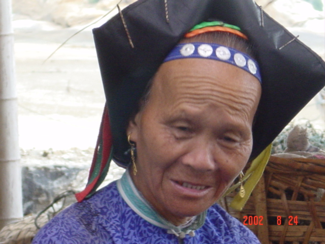 Most of the older women were clothed in traditional dress, including elaborate headwear.