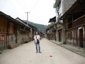 #2: Targ in the main street of Shuāngjiāng, which consisted predominantly of old wooden buildings, with a few new brick and tile structures sprouting up amongst them.