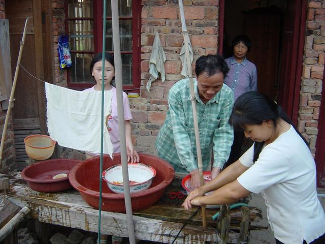 Washing hands before dinner (left to right: daughter, village chief, mother, wife)